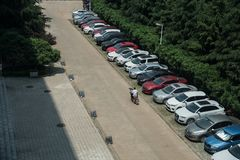 May cars parked by the roadside. There are may cars parked by the roadside, wuhan city, hubei province china. with more and more chinese owning cars, parking has royalty free stock image