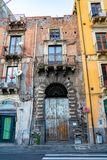 May 10, 2018. Catania, Italy. Narrow cosy streets of Catania with small buildings, and different restaurants stock images