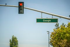May 2017 Cupertino California Google - Google street name and empty road with street light. May 2017 Cupertino California  Google - Google street name and empty Stock Photos
