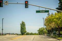 May 2017 Cupertino California Google - Google street name and empty road with street light. May 2017 Cupertino California Google - Google street name and empty Stock Photo