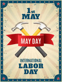 May Day background. May Day. May 1st. background with two hummers and red ribbon. Poster, greeting card or brochure template with colorful rays and stars Royalty Free Stock Photography