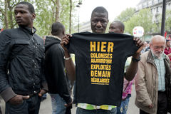 May Day Demonstration, Paris, France. May Day, 1 May, Demonstration, African Illegal Immigrant Holding T-Shirt Royalty Free Stock Photo