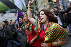 May Day in Istanbul. An unidentified woman shouts slogans at a May Day rally on May 1, 2011 in Istanbul's Taksim Square,Turkey. The event attracted thousands of Royalty Free Stock Photography