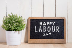 May Day, May 1. Small chalk board with text Labor Day. International Workers' Day stock photo