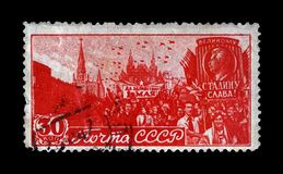May Day Parade on Red Square with Stalin placard in Moscow, circa 1947,. MOSCOW, USSR - CIRCA 1947: canceled stamp printed in USSR shows May Day Parade on Red Royalty Free Stock Images