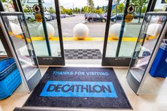 May 26, 2019 Emeryville / CA / USA - Thanks for visiting door mat at the exit from the newest Decathlon Sporting Goods flagship. Store, the first open in the royalty free stock images