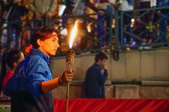 19 May 2019 Eskisehir Turkey. Young boy holding fire torch that symbolises the independence of Turkish nation on 19 May National. Independence Parade royalty free stock photo