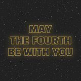 May the fourth be with you. Sci-fi yellow neon glowing letters on space background.  Royalty Free Stock Image