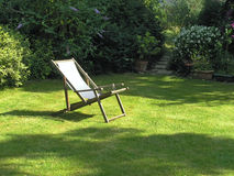 May Garden. English garden with deckchair in May Stock Photos