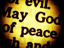 May God of peace... - close up. A macro look at a New Testament biblical passage focusing on the words May God of Peace. Sepia tone. Very low DOF Royalty Free Stock Image