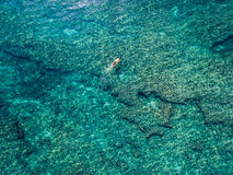 May 15 2016, Haleiwa Hawaii. Aerial view of an unknown Stand up Paddle boarder surfing in the Ocean Royalty Free Stock Photography