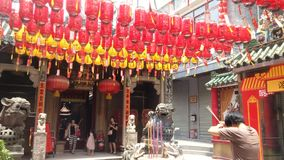 Shenzhen, China: people worship incense in Xixiang`s ancient temple. stock video