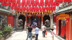 Shenzhen, China: people worship incense in Xixiang`s ancient temple. stock footage
