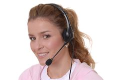 May I Help You. Beautiful girl wearing headset at help desk Royalty Free Stock Image