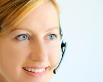 May I help You?. Girls happy face with cell phone Royalty Free Stock Images