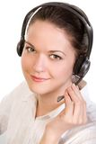 May I help you?. Young beautiful smiling woman with headset, isolated on white Royalty Free Stock Photos