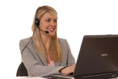 May I Help You Two. Business lady at computer with headset on Stock Photos