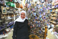 2.May.2016. Israel. Copts, a Muslim grandmother in his store. Muslim grandmother wearing white hijab, looking and smiling on the street royalty free stock images