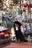 2.May.2016. Israel. Copts, a Muslim grandmother in his store. Muslim grandmother wearing white hijab, looking and smiling on the street stock photos