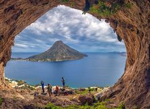 MAY 6, 2019. KALYMNOS, GRECE. Climbers in one of the popular climbing grottos with Telendos island on background
