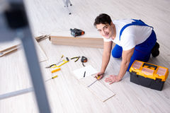 The may laying laminate flooring at home. May laying laminate flooring at home royalty free stock photo