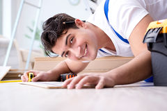 The may laying laminate flooring at home. May laying laminate flooring at home stock image