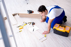 The may laying laminate flooring at home. May laying laminate flooring at home stock photo