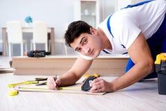 The may laying laminate flooring at home Stock Images