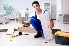 The may laying laminate flooring at home Stock Photography