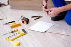 The may laying laminate flooring at home Stock Photo