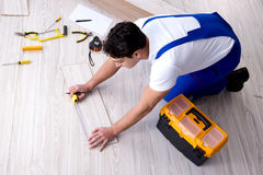 The may laying laminate flooring at home Stock Photo