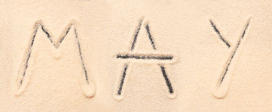 May lettering drawn on sand Royalty Free Stock Image