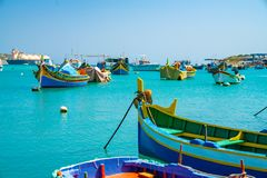 Malta. Beautiful view on the traditional eyed colorful boats Luzzu in the Harbor of Mediterranean fishing village Marsaxlokk, Malt. May 20, 2018. Marsaxlokk Stock Images