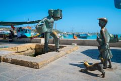 Statue of the fisherman and the car waiting for the fish. May 20, 2018. Marsaxlokk, Malta. Statue of the fisherman and the car waiting for the fish Stock Photos