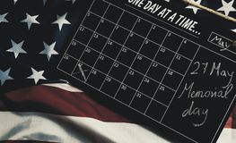 27 May, Memorial day, in calendar on american states flag stock photos