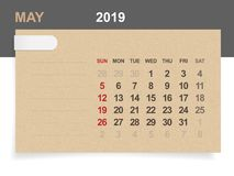 May 2019 - Monthly calendar on brown paper and wood background. Vector Illustration