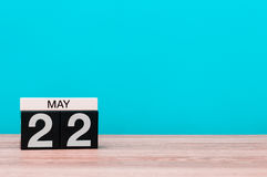 May 22nd. Day 22 of month, calendar on turquoise background. Spring time, empty space for text Stock Photography