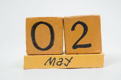 May 2nd. Day 2 of month, handmade wood calendar isolated on white background. Spring month, day of the year concept. May 2nd. Day 2 of month, handmade wood cube stock image