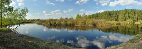 May panorama quiet forested river. Royalty Free Stock Photos