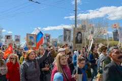 May 9, 2018: Photo of people with placards at the rally. `Immortal Regiment`. Cheboksary. Russia royalty free stock photography
