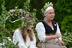 May Queen and her escort in medieval May Day reenactment Royalty Free Stock Photos