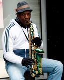 S man playing the saxophone on St. Patrick`s street in Cork, Ireland stock photos