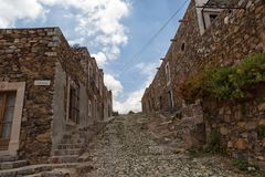 Colonial cobblestone street Real de CAtorce Mexico. May 22, 2014 Real de Catorce, Mexico: while most of the town is still abandoned and in ruins, some of the Royalty Free Stock Photography