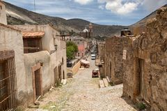 Street view of Real de Catorce Mexico. May 22, 2014 Real de Catorce, Mexico: street view of the mostly abandoned silver mining town with most of its buildings Royalty Free Stock Images