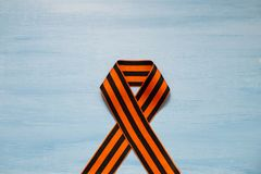 May 9 russian holiday, victory day, banner or poster. St. George striped ribbon on blue background. May 9, victory day, banner or poster. St. George striped stock photos