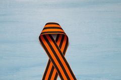May 9 russian holiday, victory day, banner or poster. St. George striped ribbon on blue background. May 9, victory day, banner or poster. St. George striped royalty free stock image