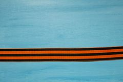 May 9 russian holiday, victory day, banner or poster. St. George striped ribbon on blue background. May 9, victory day, banner or poster. St. George striped royalty free stock photography