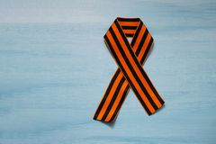 May 9 russian holiday, victory day, banner or poster. St. George striped ribbon on blue background. May 9, victory day, banner or poster. St. George striped royalty free stock photos