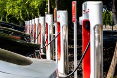 May 5, 2019 San Jose / CA / USA - Tesla vehicles plugged in at a charging station in south San Francisco bay area; Silicon Valley stock photos