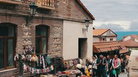 MAY 2017, SIGNAGHI, GEORGIA: Tourists pass along the streets by souvenir shops.The beautiful Georgian town of Sighnaghi stock footage